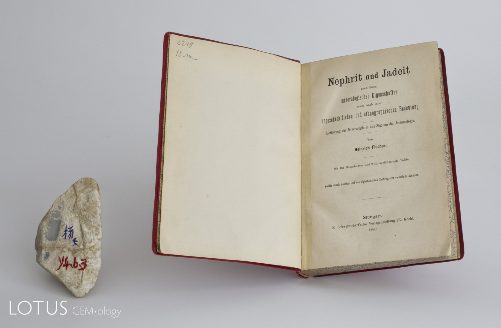 "Title page from the 1880 edition H. Fischer's Nephrit und Jadeit. Initially published in 1875, it was the first monograph in an Occidental language to be solely devoted to jade. At left is a piece of rough Burmese ""ice"" jadeite, with a small window polished through the skin."