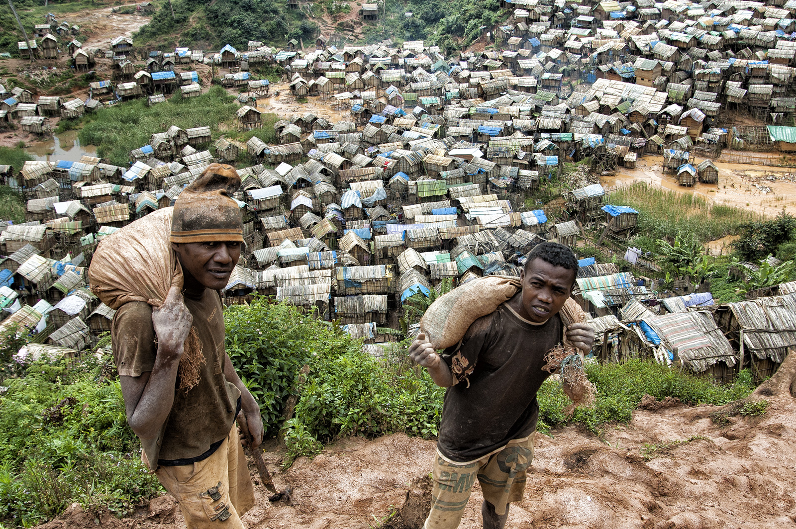 Malagasy miners carrying gem-bearing gravel above Moramanga village, deep in the Madagascar bush. Photo: R.W. Hughes, September 2005.