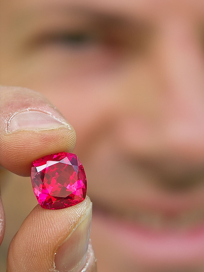 Eric Saul displays a spectacular red Mahenge spinel, cut from one of the large crystals found in the summer of 2007
