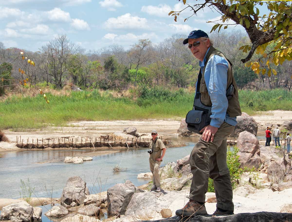 Monty Chitty (foreground) and his son, Warne, along the Muhuwesi river in Tanzania's Tunduru district. Lotus Gemology.