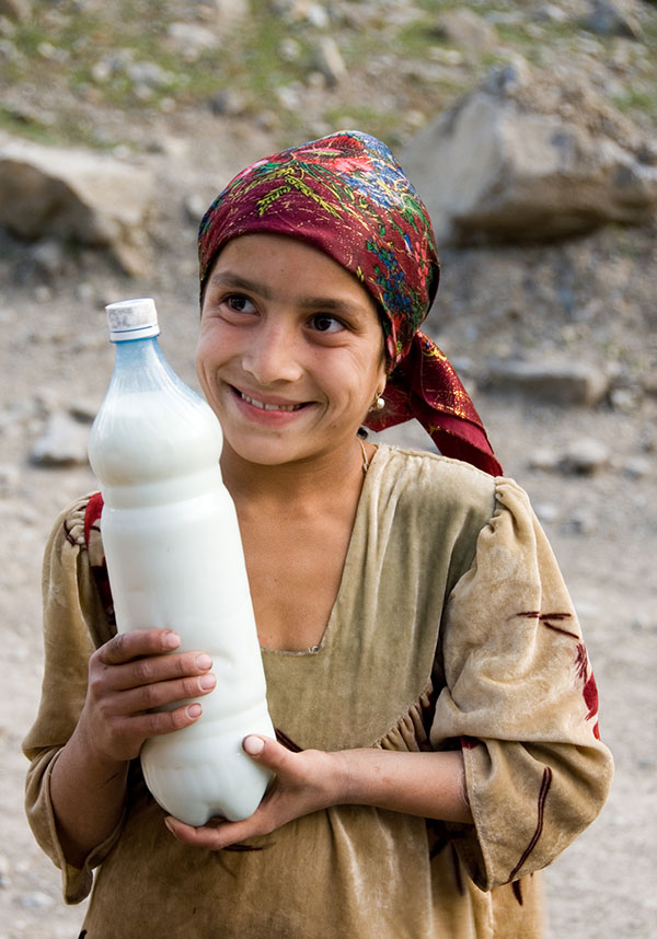 Got milk? A Tajik girl offers fermented milk to weary travelers in the remote Badakhshan region of Tajikistan