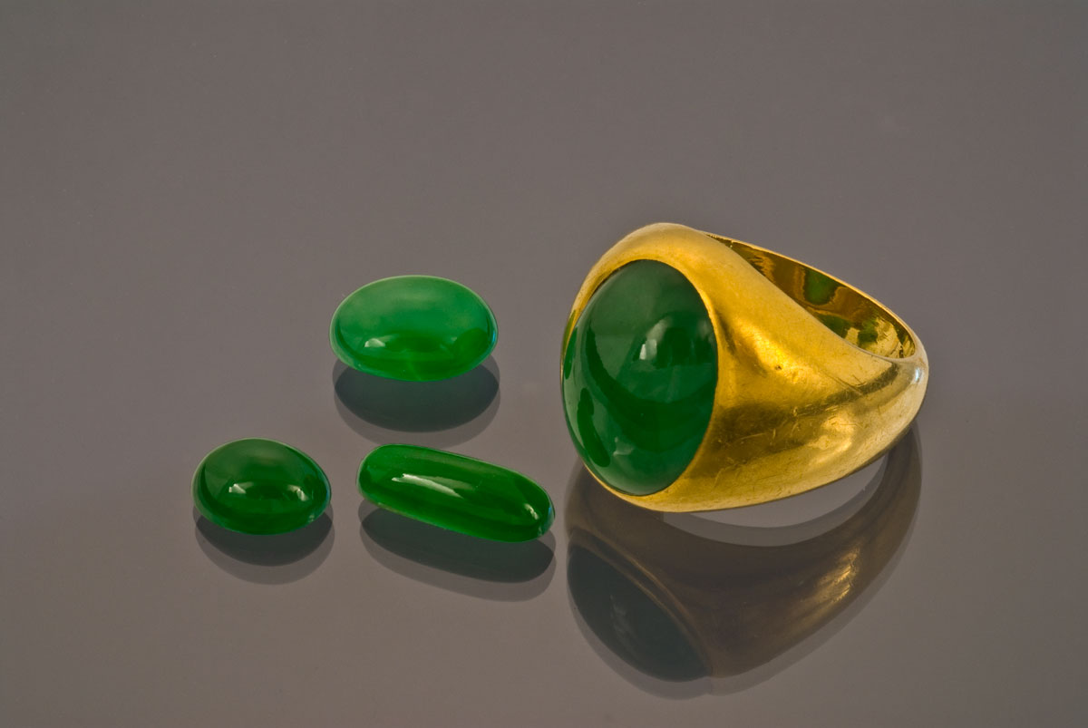 Figure 5. Fei-ts'ui Imperial jadeite ring and cabochons. Courtesy Pala International; photo: Wimon Manorotkul