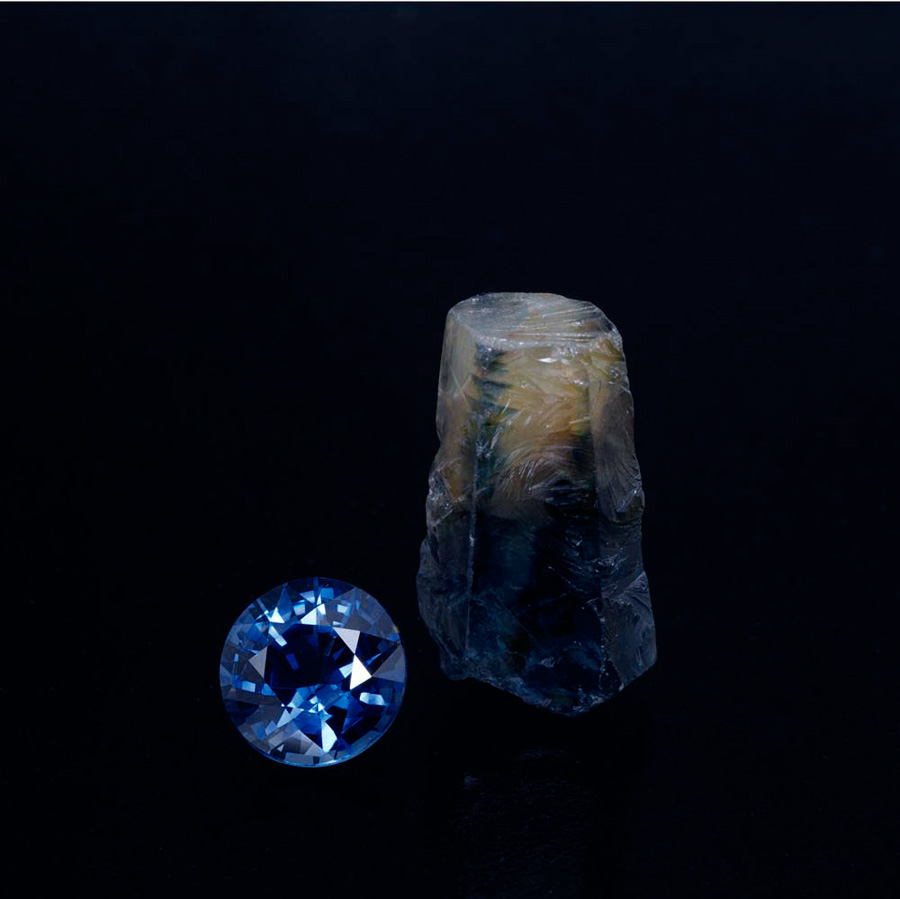 This 2.14-ct cut stone is an example of the finest production from Huay Xai. It sits next to an 11.99-ct parti-colored crystal, also from Huay Xai.
