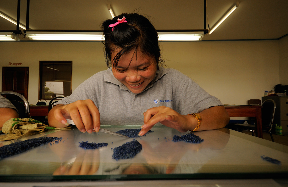 Sorting rough sapphire at SinoRMC's Huay Xai operation. SinoRMC is one of the largest private employers in Laos' Bokèo District.