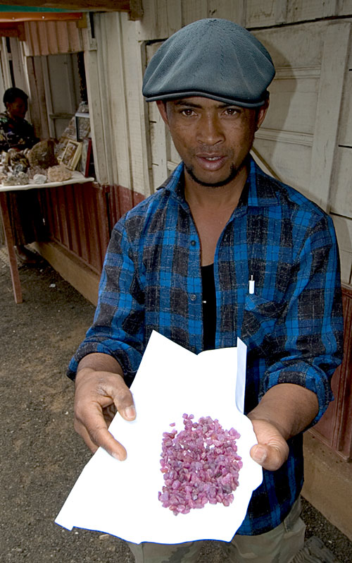 Ambohimandroso ruby rough on offer in the gem market at Antsirabe. Photo: Richard W. Hughes