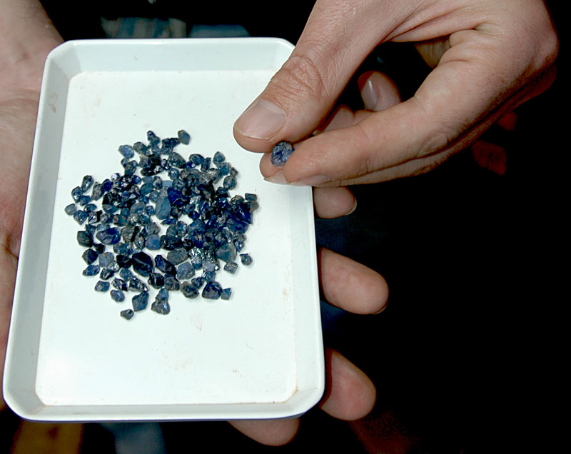 A plate of Andrebabe sapphires on offer in Andilamena. Photo: Richard W. Hughes
