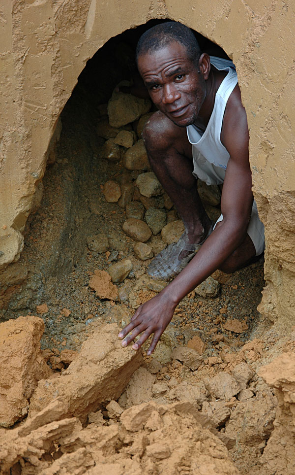 Our Malagasy guide, Gaeton, emerging from a pit at Andrebabe. Photo: Richard W. Hughes