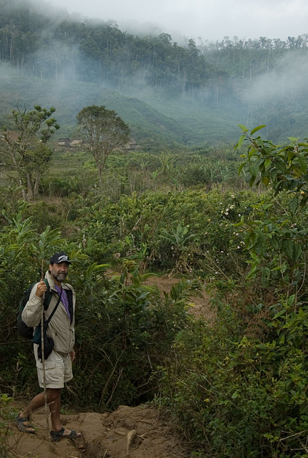 Dana Schorr on the trail to Moramanga a tough and extremely muddy jungle walk from Andilamena. Photo: Richard W. Hughes