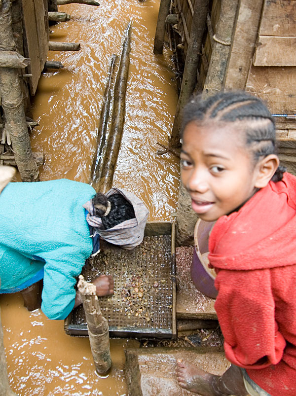 Mining the muddy streets of Moramanga. Photo: Richard W. Hughes