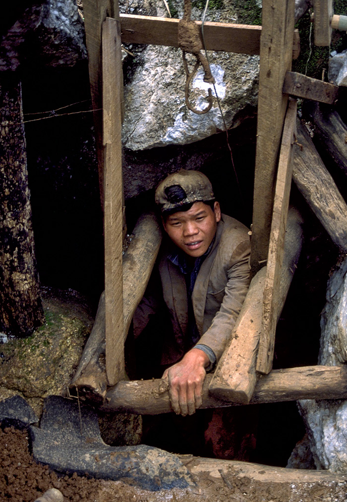 A Kokang Chinese miner emerges from a loodwin at Kyauk Saung, near Mogok