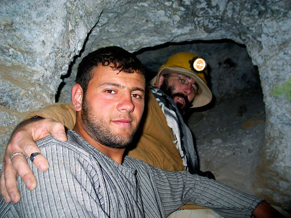 A miner with Vincent Pardieu inside the old galleries at Kuh-i-Lal