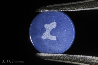 "The engraved ""L"" on the back of a genuine Linde synthetic star ruby. All of the Linde production featured this branding."