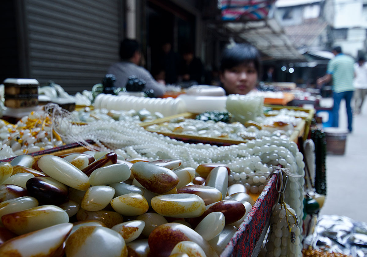 Figure 13. What appears to be Chinese nephrite in Guangzhou's Hualin Street jade market. The stains on the surfaces of these stones are possibly artificial. Photo: Richard W. Hughes.