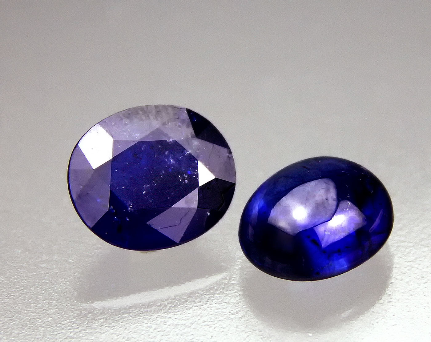 Figure 1. Two blue stones weighing 7.57 ct (left) and 6.62 ct (right) submitted to GIT for testing in May 2012. Photo: Warinthip Krajae-Jan