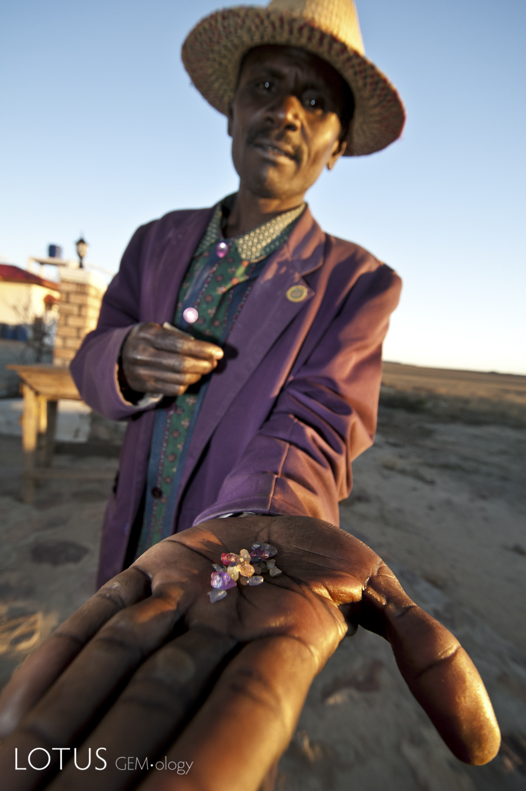 A sapphire trader with his latest offerings at Manombo, near Ilakaka, Madagascar. Photo: R.W. Hughes, 2010.