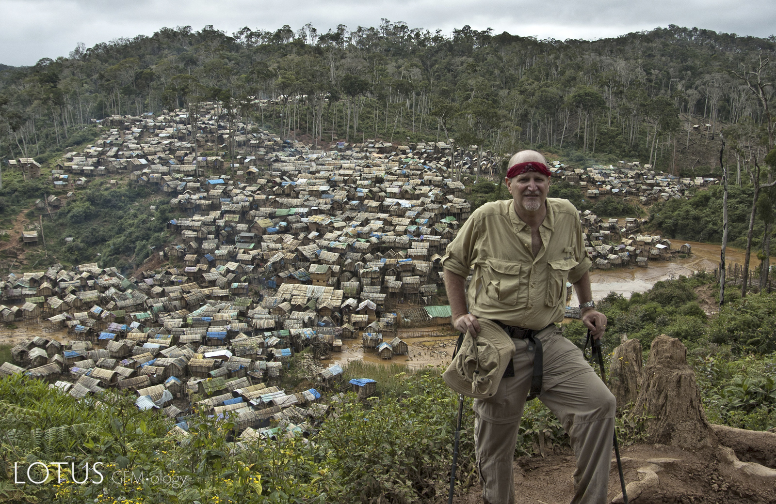 The author above Moramanga, Madagascar in 2005. The area at the time was producing large quantities of ruby used for glass filling, as well as polychrome sapphire. Photo: Dana Schorr.