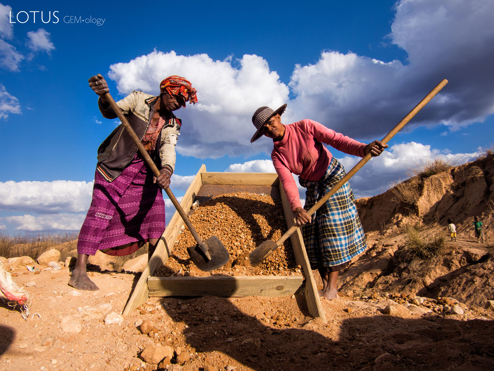 Sapphire Miners Near Ilakaka, Madagascar Figure 3. Miners move gem-bearing gravel near Ilakaka. Most of the sapphire production in Madagascar is by small-scale miners working with artisanal tools. Photo by E. Billie Hughes.