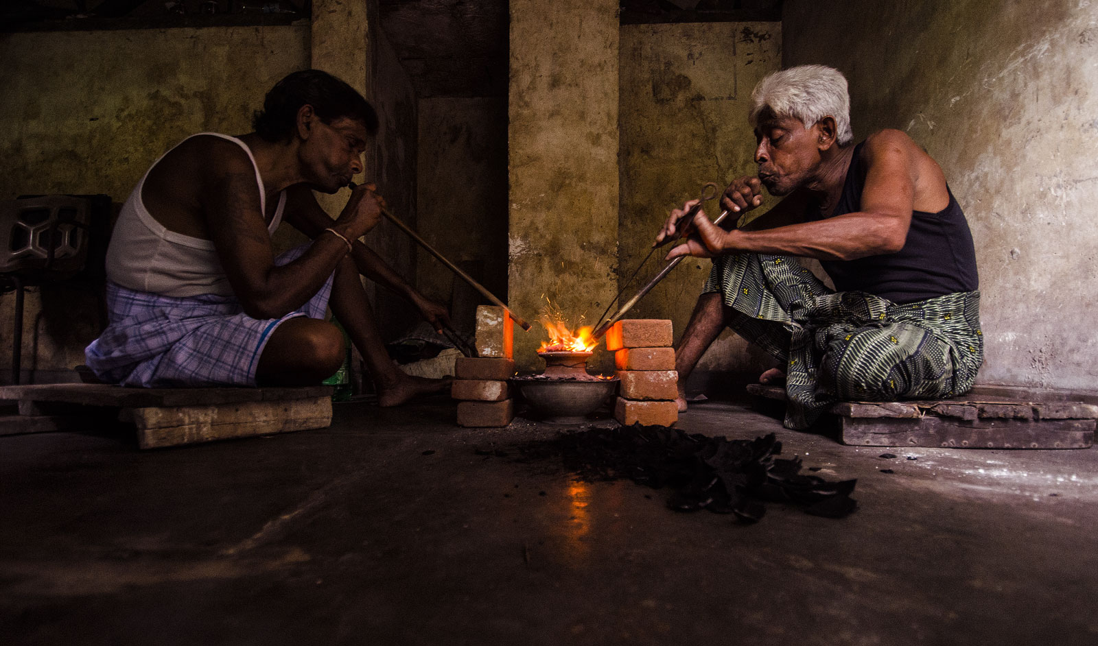 Treaters practicing the ancient art of blowpipe heating in Ratnapura, Sri Lanka. As described by al Beruni ca. 1045 AD, the temperatures reached by this technique exceeds that of the melting point of gold (1064°C)