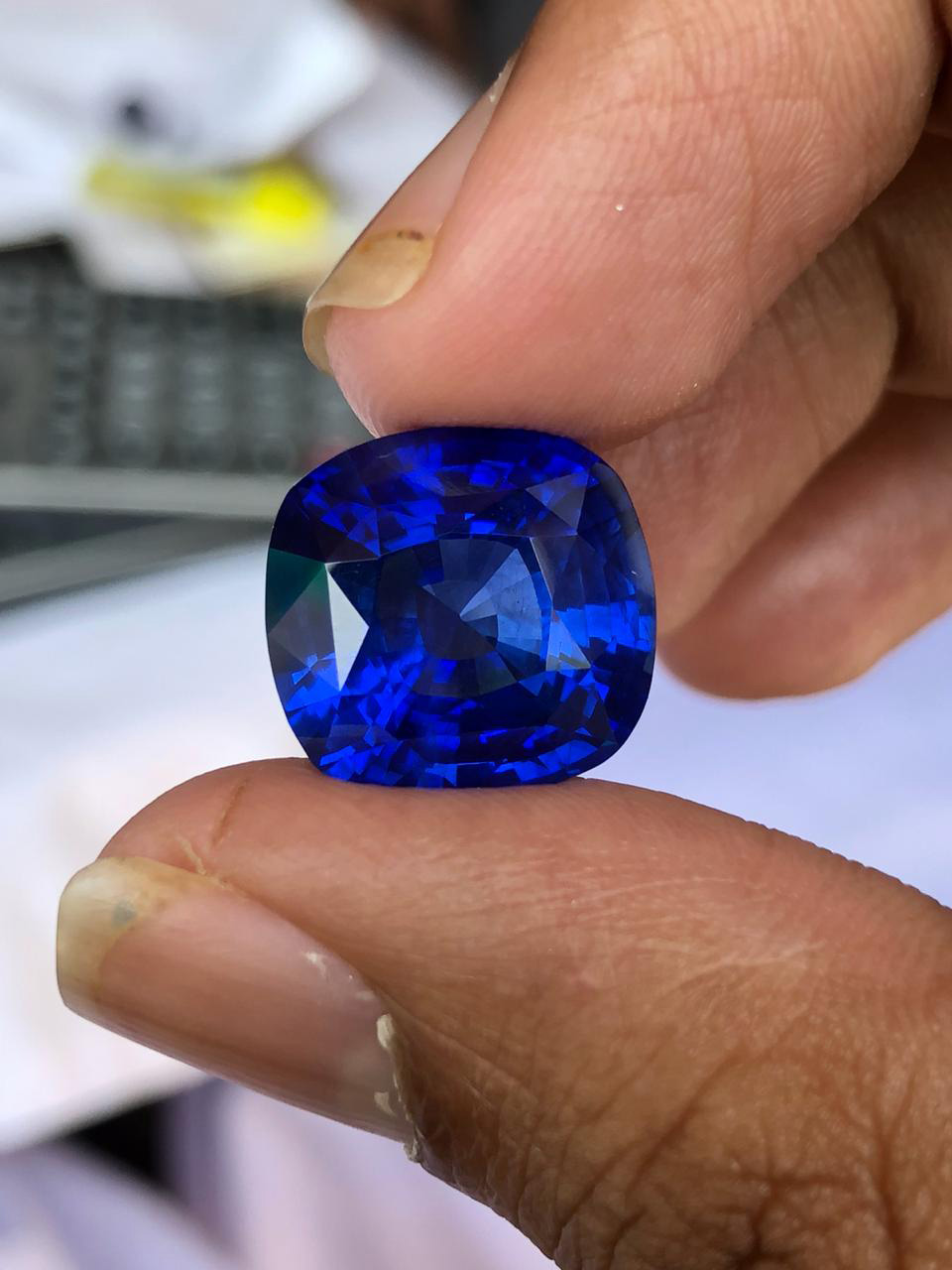 Right: The same sapphire after final polishing. Obviously, a paper clip could scratch the graphite crust, but it would have no impact on the sapphire after polishing.