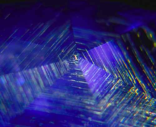 Gossamer… A rutile silk spider's web spun beneath the facets of an untreated Sri Lankan sapphire. Photo: Richard W. Hughes, Lotus Gemology.