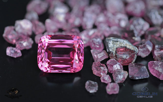 Fine Pamir spinel (over 20 carats) from Tajikistan, with rough spinels from the Kuh-i-Lal mines. Photo: Vincent Pardieu/Gübelin Gem Lab, 2008.