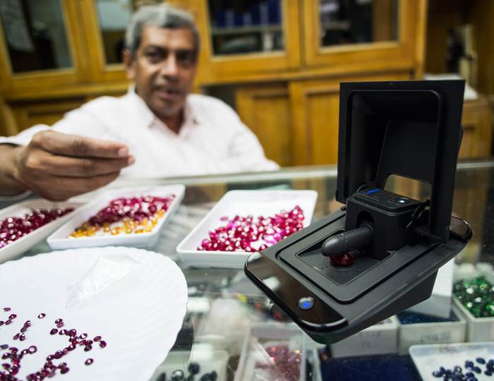 The Presidium Synthetic Ruby Identifier in action. This author took the SRI for a field test in the Wat Koh, a Bangkok neighborhood where dealers specialize in imitation and synthetic gemstones.