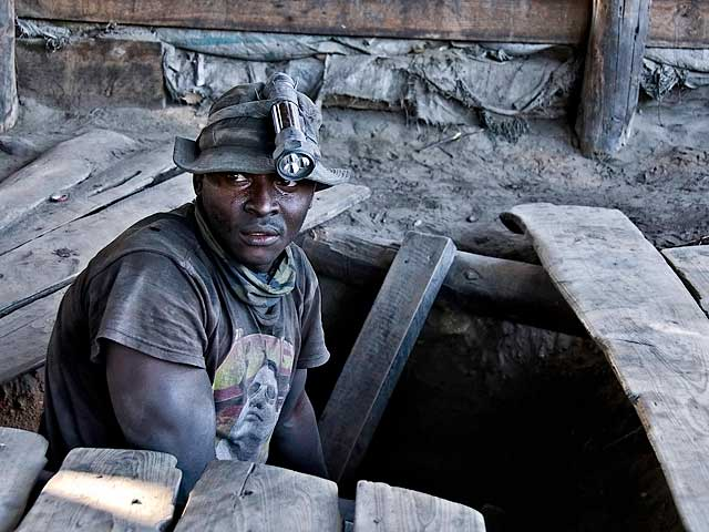 A graphite-coated miner emerges from the shaft at Merelani's Block D. Photo: Richard W. Hughes