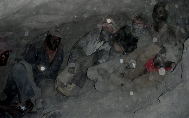 Guillaume Soubiraa and Philippe Brunot in the tight confines of a tanzanite mine at Merelani's Block D, along with local miners. Photo: Vincent Pardieu
