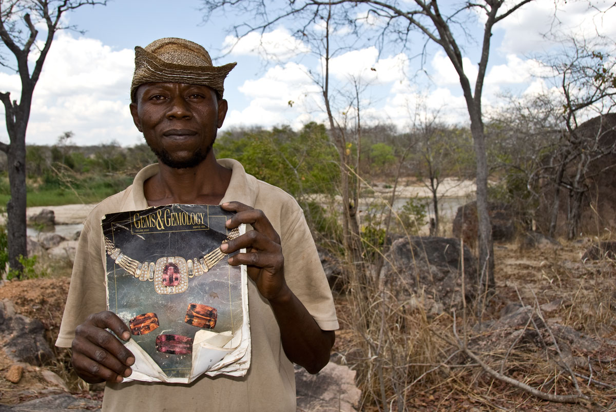 Miner Joseph Mayunga displays one of his prize possessions, a Gems & Gemology magazine that includes an article on the gems of Tanzania, given to him by a Sri Lankan dealer after a successful chrysoberyl deal. At the time of our visit in October, 2007, Joseph had been living and mining at the Muhuwesi river for more than seven years. Photo: Richard W. Hughes