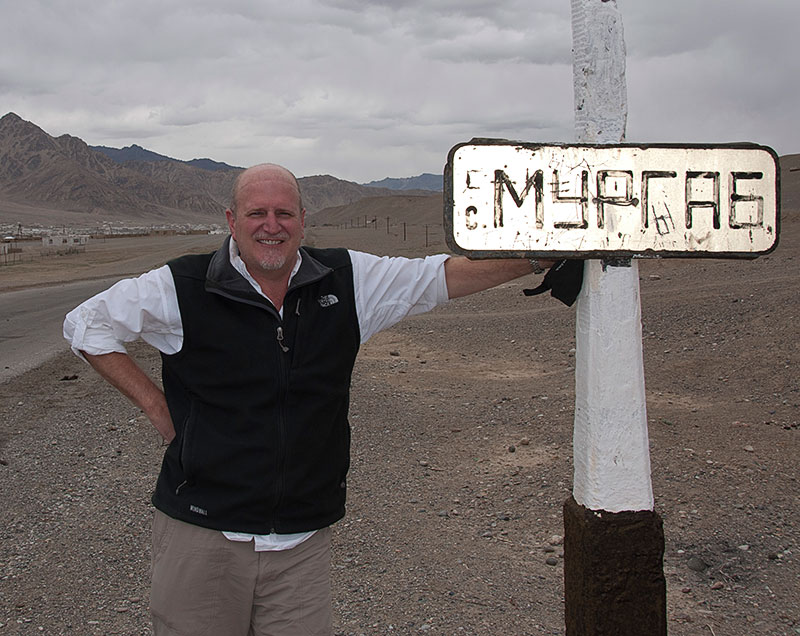 Richard Hughes on the outskirts of Murgab, in the remote Badakhshan region of Tajikistan. Imagine a photo of you next to the sign. Photo © Richard W. Hughes.