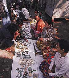 Figure 17. Vendors work the morning jadeite market in Mandalay. Photo © 2000 Fred Ward.