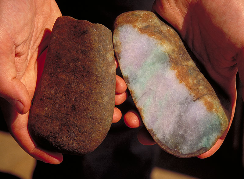 "Top left: This jadeite boulder shows the relatively thin skin and potentially good color that is usually associated with ""river jade."" Although from the outside this appears to be a normal jadeite boulder, oxidants that entered through cracks on the surface have produced a large area of discoloration."