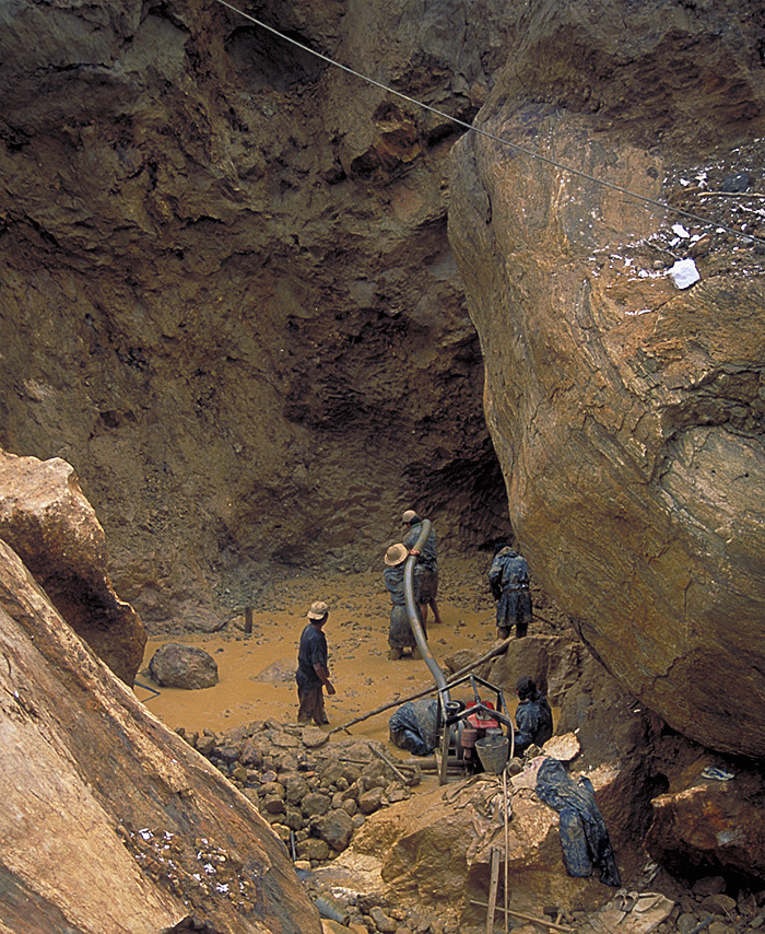 Miners at Inn Chauk, just north of Mogok, are dwarfed by massive limestone boulders as they hunt for rubies. Photo: R.W. Hughes