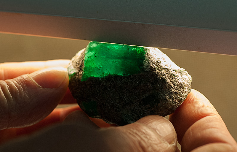 Lotus Gemology Bangkok: A large Russian emerald crystal still embedded in the mica schist. Photo: Richard W. Hughes