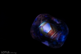 Seeing the chalky hexagonal banding in short-wave UV light reveals that this sapphire from Burma was heated. Photo taken with M&A Instruments Deep-UV Fluorescence system.